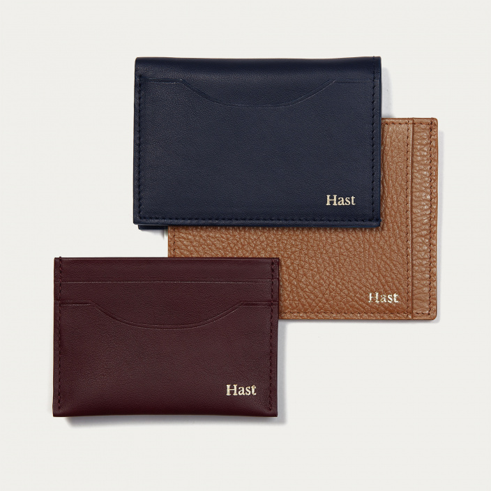 Brown breaded leather cards holder